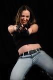 A mulher com uma pistola fotografia de stock royalty free