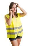 Mulher com uma veste do refletor Fotos de Stock Royalty Free