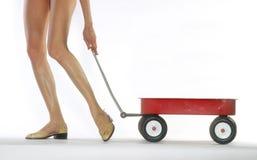 Mulher com vagão vermelho Fotos de Stock Royalty Free