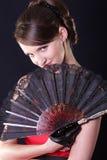 Mulher com ventilador Imagem de Stock