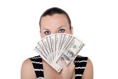 Mulher com wad de contas de dólar fotos de stock royalty free