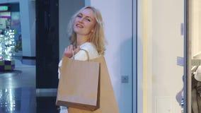 A mulher compra na alameda filme