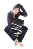 Mulher confusa com a pilha de livros Fotografia de Stock Royalty Free