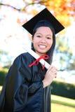 Mulher consideravelmente asiática da graduação Fotos de Stock Royalty Free