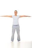 A mulher da aptidão com mãos jorra esticado Imagens de Stock Royalty Free