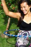 Mulher da aro de Hula Imagem de Stock