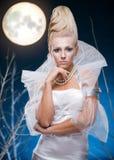 Mulher da beleza sob a lua Foto de Stock Royalty Free