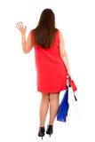 A mulher da compra dá uma onda adeus Imagem de Stock Royalty Free