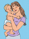 Mulher da mamã com um bebê em seus braços Imagem de Stock