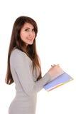 Mulher da parte traseira, escrita, organizador do caderno da terra arrendada à disposição e Imagens de Stock