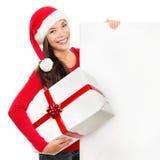Mulher da placa do sinal do Natal Fotografia de Stock Royalty Free