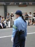Mulher da polícia em Japão Imagem de Stock