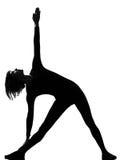 Mulher da posição do pose do triângulo do trikonasana de Utthita Fotos de Stock Royalty Free