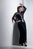 Mulher da sensualidade no vestido preto Imagens de Stock Royalty Free