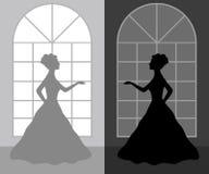 Mulher da silhueta em um vestido de bola Fotos de Stock Royalty Free