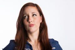 Mulher de cabelo vermelha de Piuzzled imagem de stock royalty free