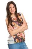 Mulher de cabelos compridos bonita de sorriso com braços cruzados Foto de Stock Royalty Free