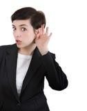 Mulher de Earesdropping imagem de stock royalty free