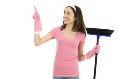 Mulher de limpeza que mostra o espaço do produto foto de stock royalty free