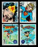 Mulher de maravilha dos EUA e selos de porte postal de Supergirl Imagens de Stock Royalty Free