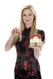 A mulher de negócio anuncia bens imobiliários Imagem de Stock Royalty Free