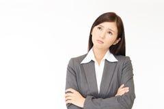 Mulher de negócio asiática inquieta fotografia de stock