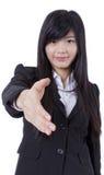 A mulher de negócio bem sucedida estica para fora sua mão imagens de stock