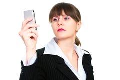 Mulher de negócio bonita com telefone corporativo Fotografia de Stock