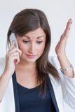 Mulher de negócio bonita nova frustrante Fotografia de Stock