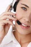 Mulher de negócio bonita nova que usa o telefone principal imagem de stock royalty free