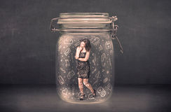A mulher de negócio capturou no frasco de vidro com ícones tirados mão dos meios Imagem de Stock Royalty Free
