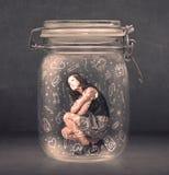 A mulher de negócio capturou no frasco de vidro com ícones tirados mão dos meios Fotografia de Stock Royalty Free