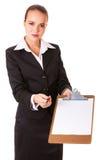 A mulher de negócio com documen assinando foto de stock