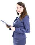 mulher de negócio com o sorriso do plano de trabalho Foto de Stock Royalty Free