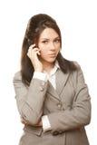 Mulher de negócio com olhar do telefone móvel na câmera fotos de stock royalty free