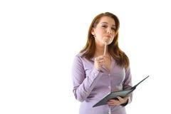 Mulher de negócio com a pena em Chin Imagem de Stock Royalty Free