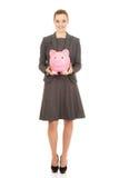 Mulher de negócio com piggybank fotos de stock