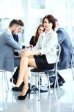Mulher de negócio com sua equipe de funcionários Fotografia de Stock Royalty Free