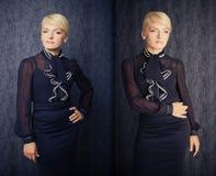 Mulher de negócio consideravelmente loura no terno preto fotografia de stock