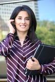 Mulher de negócio consideravelmente nova fotografia de stock royalty free