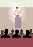 A mulher de negócio dá o discurso no estágio na conferência imagem de stock