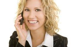 Mulher de negócio de sorriso no telefone Fotografia de Stock