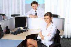 Mulher de negócio e seu colega Foto de Stock Royalty Free