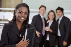 Mulher de negócio e sua equipe Fotos de Stock Royalty Free