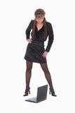 Mulher de negócio e um portátil Imagem de Stock Royalty Free