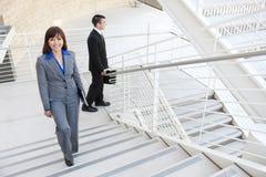 Mulher de negócio em escadas fotos de stock