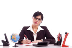 Mulher de negócio em sua mesa Fotos de Stock