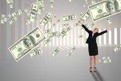 Mulher de negócio entusiasmado que olha a chuva do dinheiro contra o fundo branco fotografia de stock royalty free