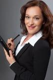 Mulher de negócio moderna com PC da tabuleta imagem de stock
