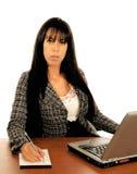 Mulher de negócio na mesa Fotografia de Stock Royalty Free